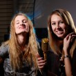 Young females with microphone — Stock Photo
