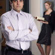 Young businessman with collegue in office — Stock Photo