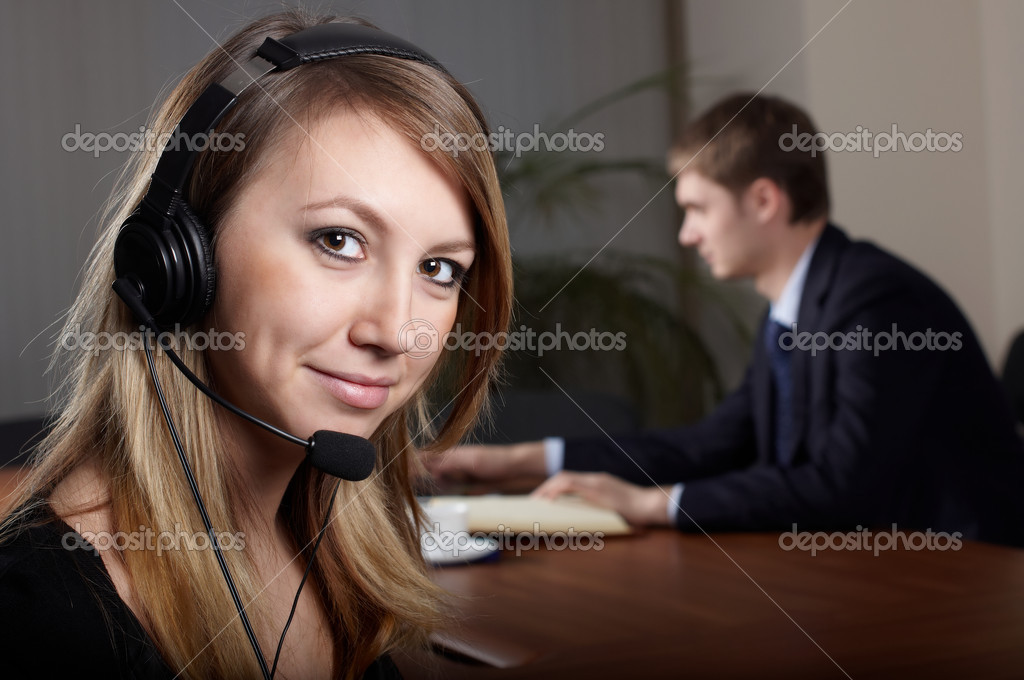 Young female talk by  headset with microphone in office  Stock Photo #1494133