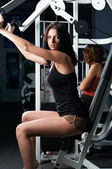 Young charming brunette in a gym — Stock Photo