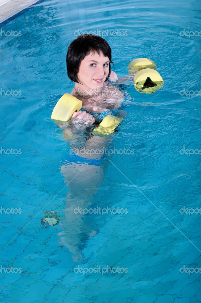 The beautiful girl the brunette swims in pool  Stock Photo #2358820
