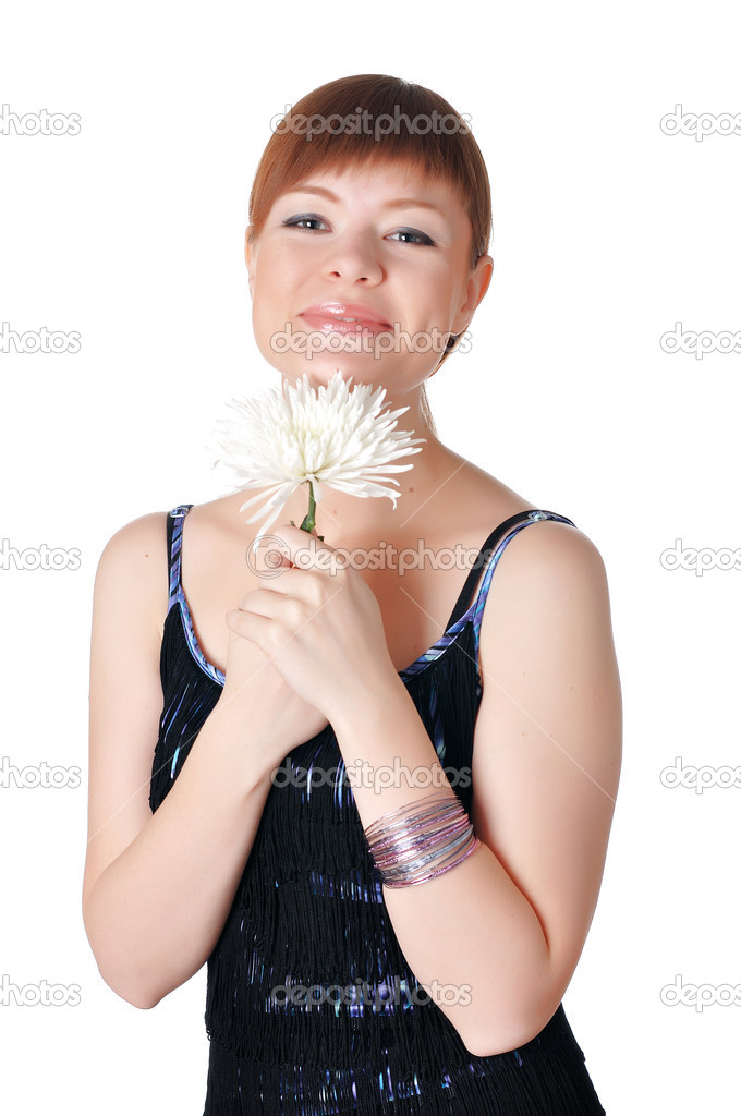 Charming young woman in evening dress with a white orchid in the hands  Stock Photo #2362840