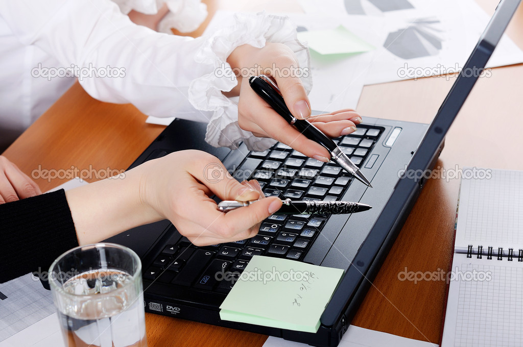 Hands of a young girl working on laptop — Stock Photo #2505862