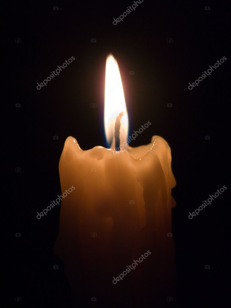 Burning candle on a black background. — Stock Photo #1951793