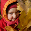 Happy girl with autumn leaves — Stock Photo