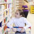 Stock Photo: Mother and daughter in supermarket