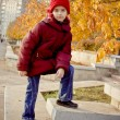 Girl with red hat at autumn — Stock Photo
