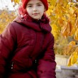 Girl with red hat at autumn — Stock Photo #1090742