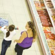 Stock Photo: Mother and daughter in supermarket.