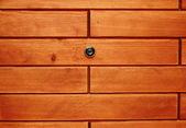 Peephole in woodden wall — Stock Photo