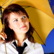 Woman with tie under yellow umbrella — Stock Photo