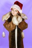 Girl in red santa — Stock Photo
