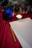 Pen, paper, candle and blue ball. — Стоковое фото