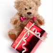 Stock Photo: Teddy bear sitting with red box gift