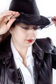 Woman eith black coat and hat — Stock Photo