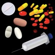 Royalty-Free Stock Vector Image: Tablets, capsules, syringe.