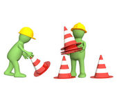 3d puppets with emergency cones — Stock Photo