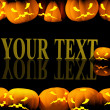 Halloween background with evil pumpkins -  