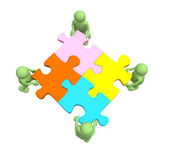Four puppets, holding in hands a puzzle — Stock Photo
