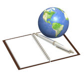 Earth and notebook — Stock Photo