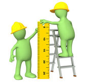 3d puppets - builders with ruler — Stock Photo