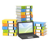 Laptop and folders — Stock Photo