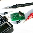 Electric board and multimeter — Stock Photo