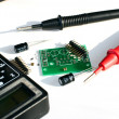 Electric board and multimeter - Stock Photo