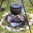 Traditional campfire cooking - Stock Photo
