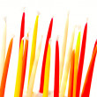 Many birthday candles over white — Stock Photo