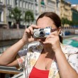 Tourist taking pictures - Stock Photo