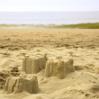 Sand castle on the beach — Stok fotoğraf