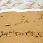 ocean słowa napisane na piasku — Zdjęcie stockowe