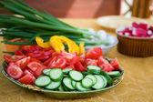 Fresh vegetables prepared for salad — Stock Photo