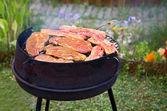 Summer grilling in garden — Stock Photo