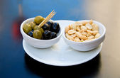 Nibbles to an aperitif — Stock Photo
