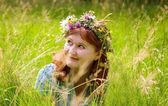 Beautiful woman in a flower wreath — Stock Photo