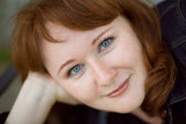 Beautiful happy redheaded woman — Stock Photo