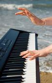 Playing music at the seashore — Stock Photo