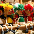 Row of five wooden toys — Stock Photo