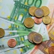 Euro banknotes and coins — Stock Photo