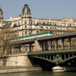 Royalty-Free Stock Photo: Parisian metro train on the Bir-Hakeim bridge over the Seine (line 6)