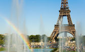 Eiffel Tower and rainbow in fountain — Stock Photo