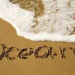 Word Ocean written on the sand — Stock Photo #1077327