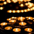 Many burning candles in a church — Stockfoto