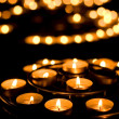 Many burning candles in a church - Stock Photo