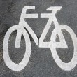 Bicycle road sign painted on asphalt — Stock Photo