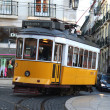 Old fashioned yellow tram in Lisbon — Stok fotoğraf