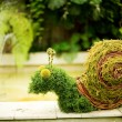 Garden decoration in form of funny snail — Stock Photo