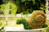 Decoración del jardín en forma de caracol divertido — Foto de Stock